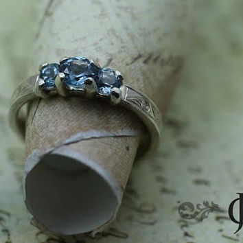 Aquamarine Waves Ring in Sterling Silver and features 3 - aquamarine stones and engraved waves