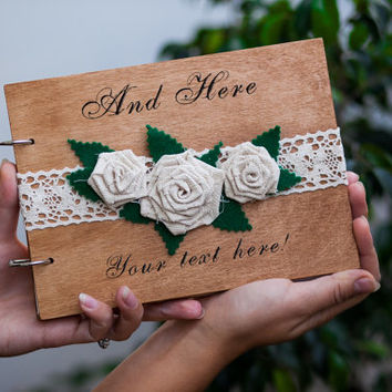 Personalized guestbook with a burlap flowers, lace and engraving. The names and wedding date