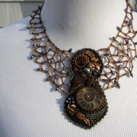 Unique Beaded Statement Necklace. Beadwoven Wearable Art Collar in Petrol Blue and Browns embellished with Pearls, Ammonite and Crystal