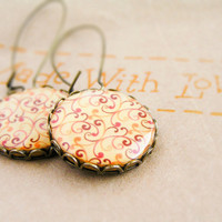 Red orange swirls earrings in antique brass by CitrusCat on Etsy
