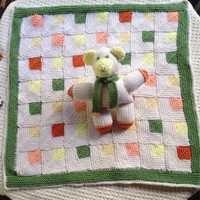 Baby's First Blanket knitted with toy bear Ready to ship White squares with green, orange, yellow and peach. Gift for baby shower