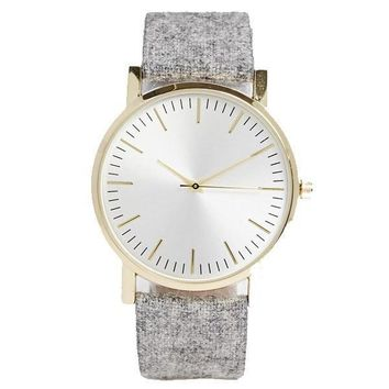 White Gold Tone and Felt Timepiece