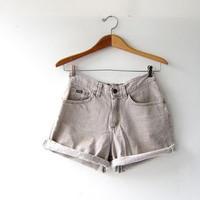 Vintage washed out brown jean shorts. high waist denim shorts. roll up shorts.