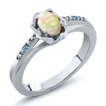 0.33 Ct Cabochon White Ethiopian Opal Swiss Blue Simulated Topaz 925 Silver Ring