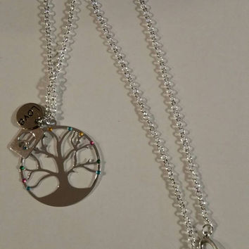 Tree of life necklace with rhinestones and charms.