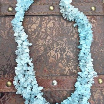 Aquamarine blue gemstone chip necklace with silver clasp.
