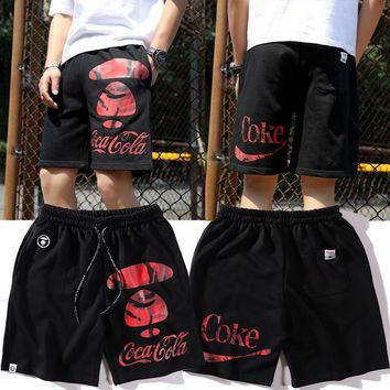DCCK 1474 AAPE x Coca Red camouflage English shorts