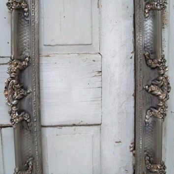 Large vintage frame ornate hand painted pewtery gray French farmhouse detailed antique silvery gold aged wall decor Anita Spero