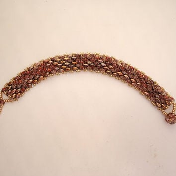 Beaded bracelet with rose lined gold super duo beads and gold Miyuki seed beads with matching toggle. Handmade