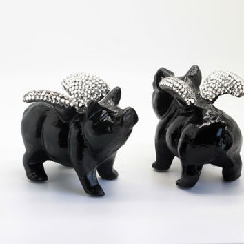 Flying Pig with Swarovski crystal-topped wings.