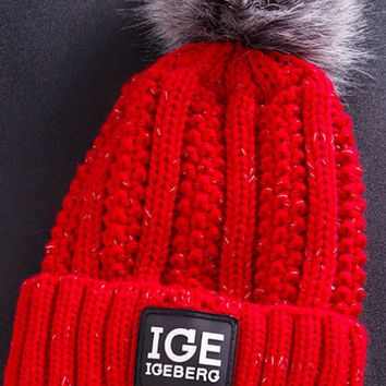 Winter outdoor extra thick letter label IGE wool hat ladies warm hair ball knit cap.