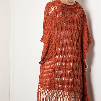 This super cute knit duster features semi-sheer pattern design, open front, side slits, short sleeves, and finish with crochet fringe at bottom hemline. Unlined. Pair with crop top, denim cut off and sandals.