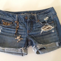 Upcycled American Eagle cut off jean destroyed leopard shorts, size 0.