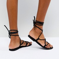ASOS FLOW Leather Tie Leg Flat Sandals at asos.com