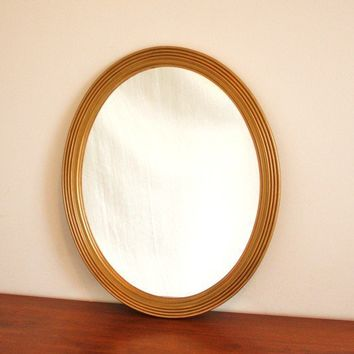 Vintage oval mirror with gold wood frame by highstreetmarket
