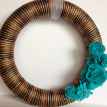Brown and blue yarn wrapped wreath with teal felt flowers