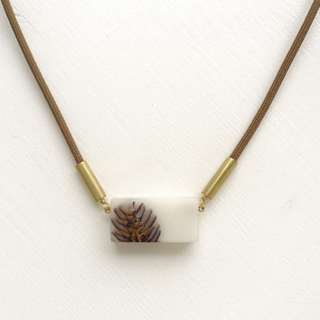 White Bioresin and pinecone pendant, brown cord