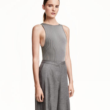 Sleeveless bodysuit in ribbed jersey with a low-cut neckline at back.