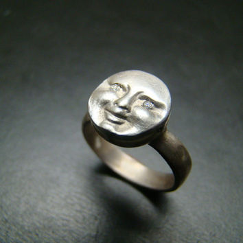 Sterling Silver moonface / sunface ring with diamond eyes.