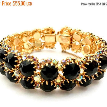 Kramer Black Rhinestone Bracelet, Opaque Black Rhinestones Framed with Aurora Borealis, Gold Tone, Slightly Domed, Vintage Designer Signed