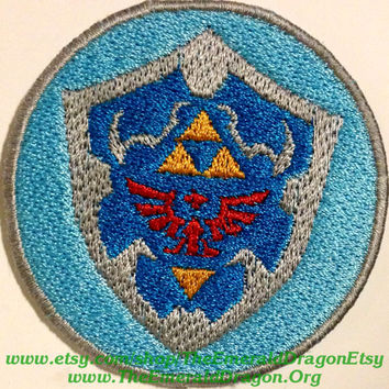 "Legend of Zelda Inspired 2.25"" Hyrulian Shield Fully Embroidered Patch With Fully Wrapped Overlocked Edges Sew/Iron On or Velcro LoZ"