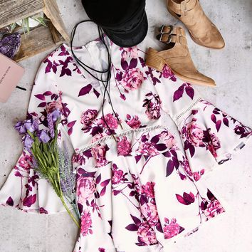 a new leaf - floral romper with bell sleeves - white/purple