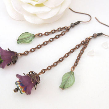 Copper earrings, purple flowers and green leaves