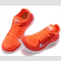 NIKE knitting flying line casual sports shoes Orange-red
