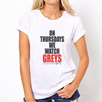 On Thursdays we watch Greys printed on Women tee