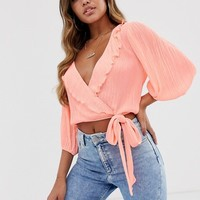 ASOS DESIGN wrap top in plisse with ruffle and tie side | ASOS