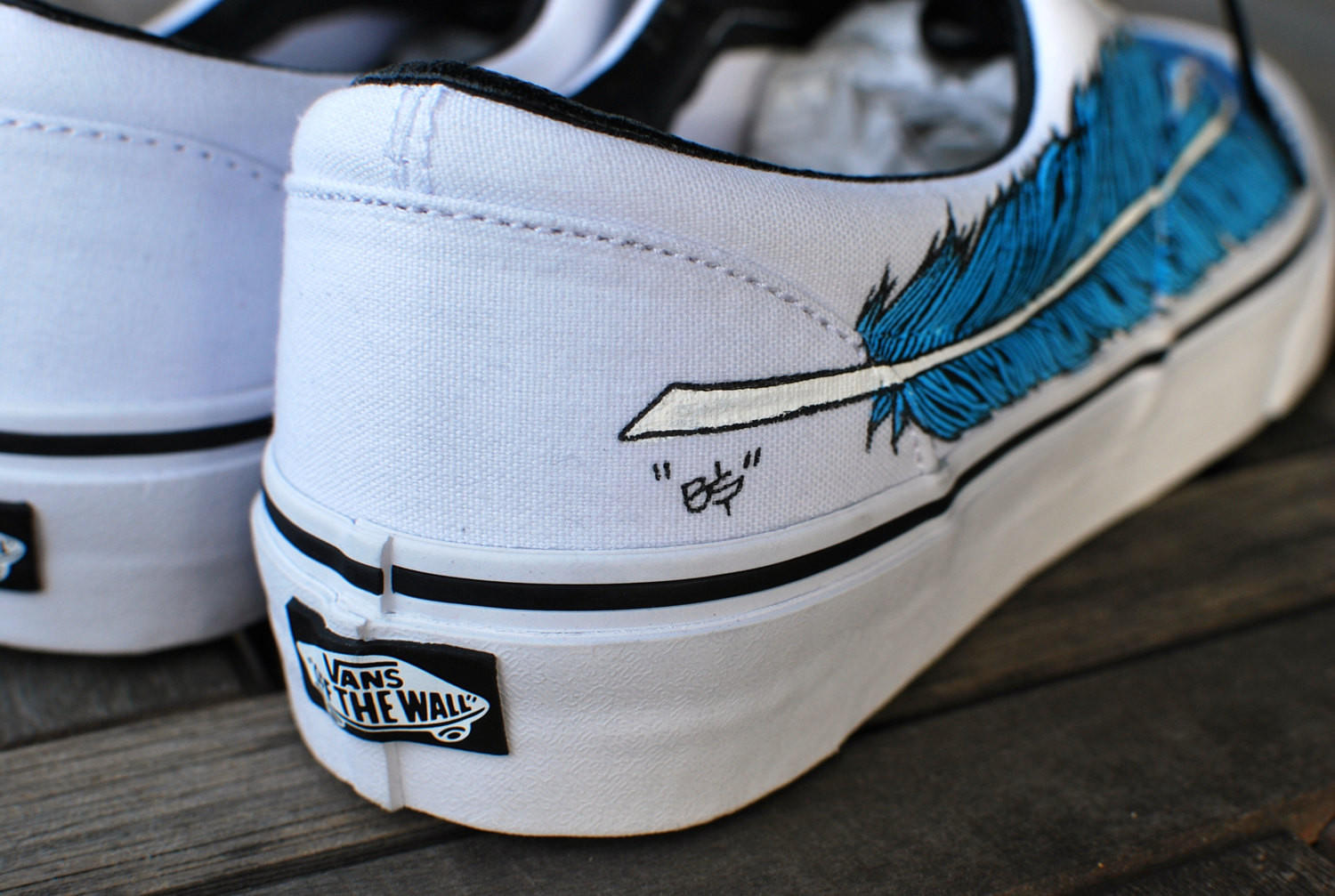 2ca1f45b1ab7 Hand Painted Eagle Feather on White Vans from bstreetshoes.com