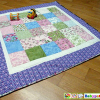 Floral baby blanket, warm and snuggly, cosy and comfy.
