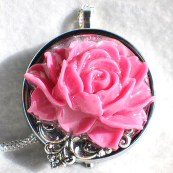 Music box locket, round locket with music box inside, in silver with dark pink  rose and silver filigree accent