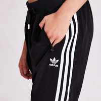 adidas Originals Adicolor Dropped Track Pant - Urban Outfitters