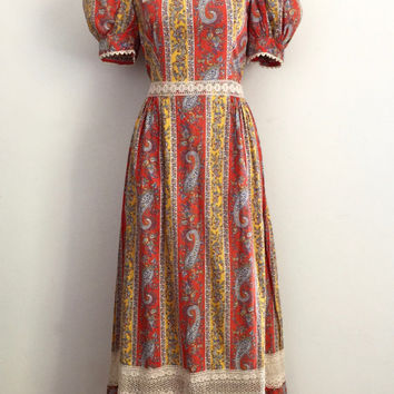 Vintage 1970s yellow and orange, paisley print, cotton prairie dress with puff sleeves, tie back and lace trims / Made in England