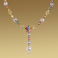 SAPPHIRE FLOWER necklace in 18kt yellow gold with fancy sapphires, pearls, diamonds and pavé diamonds.