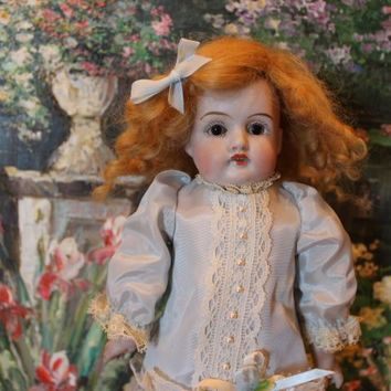 11 petite Antique German Kestner doll! No hairlines, Great kid leather body, bisque hands, mohair wig, sleep eyes, rayon dress, marked head under wig.