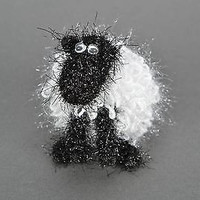 Homemade fluffy handmade sheep knitted nature item decorating office space