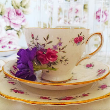 Vintage bone china floral tea set.  One cup, saucer and side plate.  Tea for one for a special gift or vintage tea party