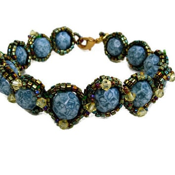 Marbled Emerald Green Beaded Bracelet decorated with Swarovski elements.