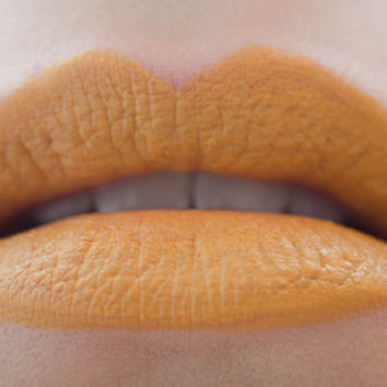 Between the Lines : a bold, semi-matte, vegan, opaque bright marigold yellow lipstick