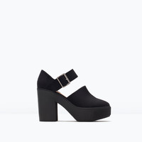 Chunky high-heeled buckled d'orsay shoes