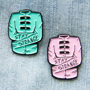 """Stay Strange"" Pastel Straight Jacket Enamel Pin"