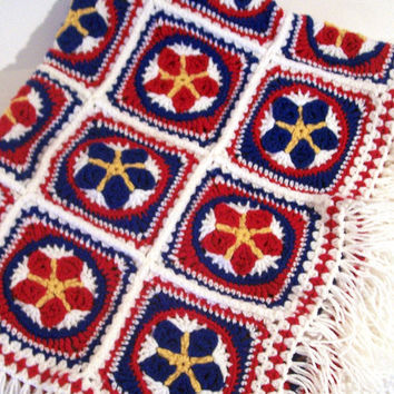 Stars and Stripes afghan with red, white, blue, and yellow granny squares and fringe