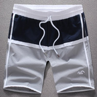 Plus Size Color Spliced Drawstring Board Shorts