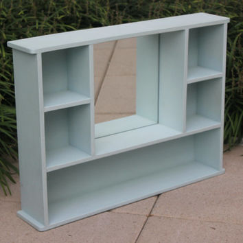 Handbuilt wood display cabinet with mirror, painted in Annie Sloan powder blue chalk paint