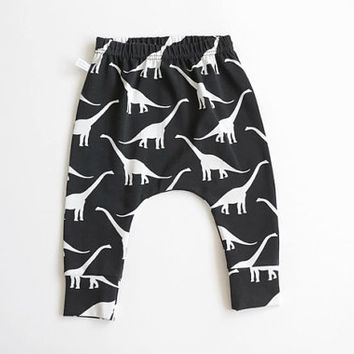 Baby infant harem pants with dinosaurs. Black jersey knit. Slim fit harem pants with cuffs. Jersey knit fabric. Infant pants. Black white