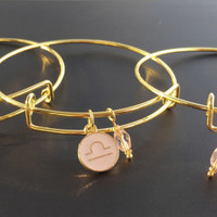 Pale pink enameled zodiac charm bangle bracelet in gold-Aquarius-Pisces-Aries-Taurus-Gemini-Cancer-Leo-Virgo-Libra-Sagittarius-Capricorn