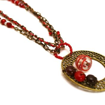 Bright Red Double Strand Necklace with Large Bronze Web Pendant
