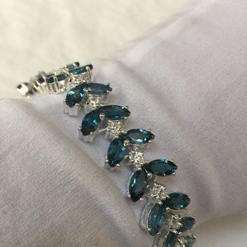 Handmade Vintage Lindon Blue Topaz Rhodium Finished Sterling Silver Tennis Bracelet